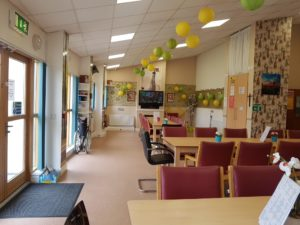 Dining area showing tables and chairs in Nethercross day centre for the elderly